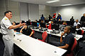 US Navy 091026-N-5208T-004 Texas Southern University aviation students listen as Rear Adm. W. Mark Skinner, Program Executive Officer-Tactical Aircraft Programs, discusses the future of naval aviation.jpg