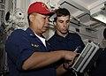 US Navy 091211-N-9520G-035 Chief Logistics Specialist Clyde Maarat shows Seaman Adam Komperda a chemical, biological and radiological drill radiation test kit.jpg