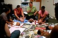 US Navy 100423-N-0641S-135 Mara MacDonald leads a group of new mothers and their babies in an infant massage class.jpg