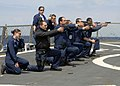 US Navy 100511-N-3542S-259 Sailors aboard the guided-missile destroyer USS Laboon (DDG 58) participate in the Beretta M-9 pistol qualification course to qualify for force protection watch standing.jpg