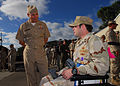 US Navy 101122-N-0046R-029 Explosive Ordnance Disposal 1st Class John Kremer speaks with Vice Adm. Richard W. Hunt,.jpg