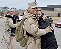 US Navy 101217-N-7440F-540 Seabees assigned to Naval Mobile Construction Battalion (NMCB) 7 are greeted by their loved ones during a homecoming cer.jpg