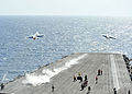 US Navy 110531-N-CH661-193 Two F-A-18F Super Hornets assigned to the Checkmates of Strike Fighter Squadron (VFA) 211 launch from the aircraft carri.jpg