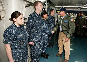 US Navy 120121-N-FI736-127 Secretary of Defense (SECDEF) Leon Panetta greets Sailors upon arrival aboard the aircraft carrier USS Enterprise (CVN 6.jpg