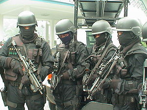 Pasukan Gerakan Khas - Four UTK operatives on standby. They are armed with MP5-Ns equipped with Aimpoint CompM2 Sight and Insight Technology flashlight.