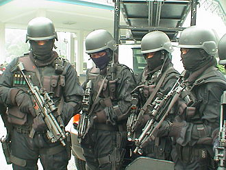Special Actions Unit (Malaysia) - Four UTK operatives on standby. They are armed with MP5-Ns equipped with Aimpoint CompM2 Sight and Insight Technology flashlight.