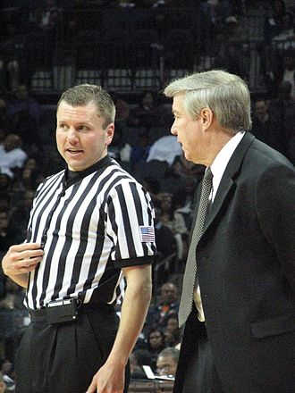 Dave Robbins (basketball) - Robbins (right) speaking with an official