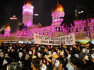Occupy Dataran - Protestors wear Guy Fawkes mask during the flash mob