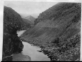 View of the Otago Cenral railway line, running alongside the Taieri River ATLIB 334905.png