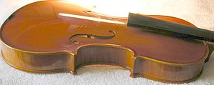Violin making and maintenance - Violin taken down, with upright soundpost visible through the sound hole.