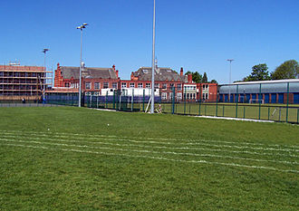 William Hulme's Grammar School - View of the Science Block in front of the Main Building. Astroturf in foreground and Donner Block (in construction) on left. Taken from original 1st XI cricket square