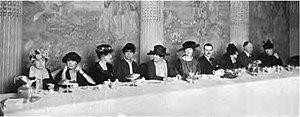 Nan B. Frank - Kathleen Norris, California author, before the San Francisco Center at a luncheon held in the colonial ballroom of the St. Francis Hotel, November, 1921. Literary folks from the bay cities were in attendance. Mrs. Parker Maddux, president of the Center, is seated at the honor table with Kathleen Norris at her right and Charles Norris at her left. Prominent members and relatives of the honor guests seated, from left to right, at the table are: Mrs. Ernest Wallace, Mrs. Joseph S. Thompson, Mrs. Ernest W. Cleary, Mrs. Ida Finney Mackrille, then, Kathleen Norris, Mrs. Parker Maddux, Charles Norris, Mrs. C.S. Stanton, Mr. Joseph Thompson (brother of Kathleen Norris) and Mrs. E.B. Thomas, Who's who among the women of California