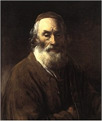 Portrait of an old man with his hand in his jacket