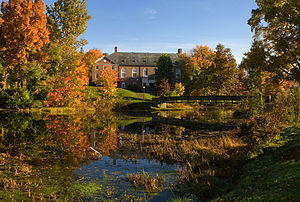 Williston Northampton School - Ford Hall and Birch Dining Commons seen from the Williston pond