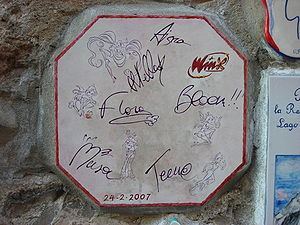 "Winx Club (franchise) - A tile in a murial in Alassio, ""autographed"" by the Winx Club."