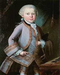 a child (Mozart) in formal embroidered 18th century costume, left hand thrust into his waistcoat. He looks directly out of the picture, although his body is turned towards the right.