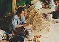 Woman makes small umbrellas Thailand.jpg