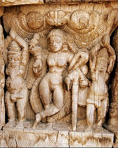 """The """"supreme seductress"""" of Hindu mythology - Mohini, the only female avatar of the male god Vishnu, depicted here with seduced sages, praying to her, details of wood carvings in a temple car belonging to the Ayodhyapattinam Sri Rama temple."""