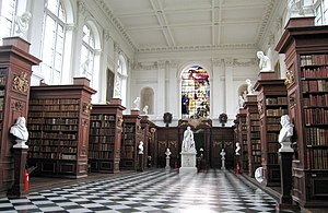 Wren Library - The interior of the library, showing the limewood carvings by Grinling Gibbons