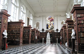Trinity College, Cambridge - Wren Library interior, showing the limewood carvings by Grinling Gibbons