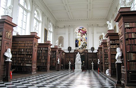 Wren Library interior, showing the limewood carvings by Grinling Gibbons WrenLibraryInterior.jpg