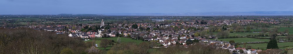 Panoramic view of the village of Yatton from Cadbury Hill, showing the North Somerset levels and the Severn Estuary in the distance