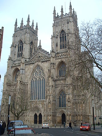 English Gothic architecture - The west front of York Minster is a fine example of Decorated architecture, in particular the elaborate tracery on the main window. This period saw detailed carving reach its peak, with elaborately carved windows and capitals, often with floral patterns.