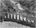 """Roosevelt Dam. View of north spillway. Concrete between piers has been completed."" - NARA - 294550.tif"