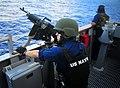090129-N-4774B-015 - A sailor mans a .50-caliber machine gun before a live-fire exercise.jpg