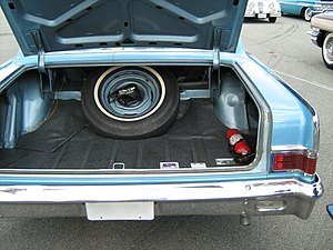 Trunk (car) - A trunk in the rear will often contain a spare tire
