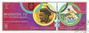 Rod Milburn - Milburn on a stamp of Umm al-Quwain