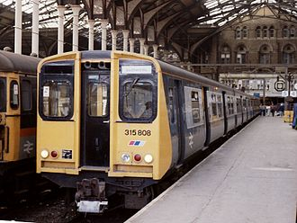 British Rail Class 315 - 315808 in British Rail livery with the addition of the Network SouthEast logo, at Liverpool Street in 1987