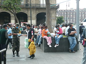 2009 flu pandemic in Mexico - Mexican soldiers distributing protective masks to citizens.