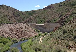 Wild Horse Reservoir - Image: 2013 06 16 13 59 05 Wild Horse Dam in Nevada viewed from down the Owyhee River, with Nevada State Route 225 on the left