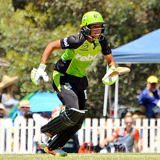 Run (cricket) - Harmanpreet Kaur taking a run while batting for Sydney Thunder, 2018.
