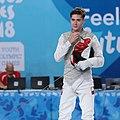 2018-10-09 Bem vs Winterberg-Poulsen (Bronze medal match Boys foil) at 2018 Summer Youth Olympics by Sandro Halank–061.jpg