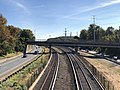 2018-10-25 11 29 38 View east along Interstate 66 (Custis Memorial Parkway) and the Orange and Silver lines of the Washington Metro from the overpass for U.S. Route 29 and westbound Virginia State Route 237 (Lee Highway) in Arlington County, Virginia.jpg