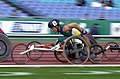 211000 - Athletics wheelchair racing 10km heat John Maclean action 5 - 3b - 2000 Sydney race photo.jpg
