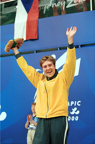 Alicia Aberley - Aberley waves to fans as she celebrates one of her bronze medal wins at the 2000 Summer Paralympics