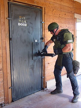 Door breaching - A battering ram is used to breach a training door