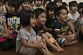 3rd Recon Marines teach Nago children, sneak learning into games 140521-M-LN208-037.jpg