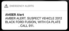 "An amber alert on iOS. Text reads in all caps ""Suspect vehicle 2012 black ford fusion, with ca plate [license plate removed]. Call 911."