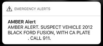 Amber alert - An AMBER alert as seen on iOS, advising users to call 911 if they find a car with a matching description.