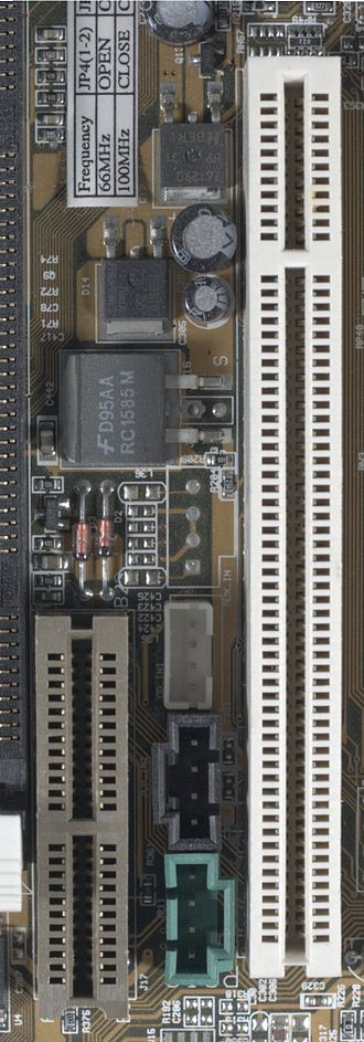 Audio/modem riser - AMR (brown, at left), with PCI slot (white, at right) for comparison