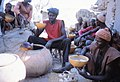 ASC Leiden - W.E.A. van Beek Collection - Dogon markets 23 - Men from one lineage sharing a jar of beer at the Market. Tireli, Mali 1980.jpg