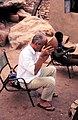 ASC Leiden - W.E.A. van Beek Collection - Dogon tourism 08 - Filmer Nigel Evans enjoys a beer, Tireli, Mali 1990.jpg