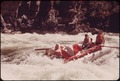 A LARGE (28 FOOT) RAFT RUNNING WILD SHEEP RAPIDS ON THE SNAKE RIVER DURING A CONSERVATION TRIP THROUGH HELLS CANYON - NARA - 549463.tif