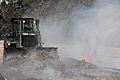 A U.S. Soldier assigned to the 497th Engineer Company, 52nd Engineer Battalion, 555th Engineer Brigade spreads out burning mulch with a bulldozer during the Black Forest fire at Colorado Springs, Colo., June 13 130613-A-UK001-989.jpg