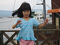 A girl dancing at a dock in Misaki, Japan; August 2009.jpg