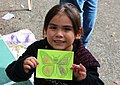 A little girl is proud to showcase her artwork at Western Monarch Day in Pismo Beach, Calif. (32368255220).jpg